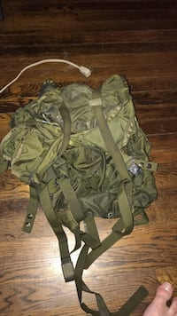 Green back pack. Military stile. Been used but in good shap