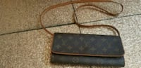 black and brown leather Louis Vuitton wristlet Goodyear, 85395