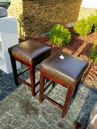 two brown wooden framed black leather padded chairs Chicago, 60623