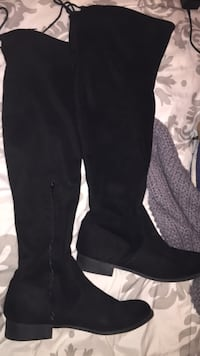 pair of black suede half-zip knee-high boots