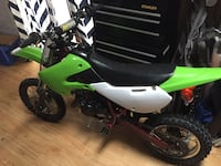 Green and white kawasaki kx65 motocross dirt bike Glenville, 12302