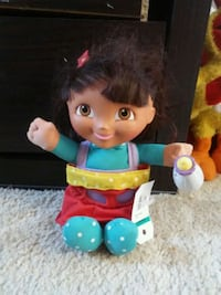 teal and red dressed girl doll