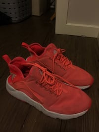 Pair of red nike huarache sneakers Calgary, T3N