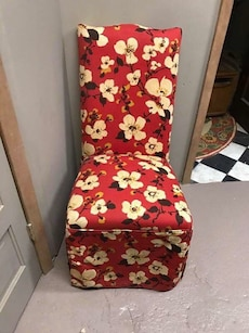 Red, white and black floral fabric chair