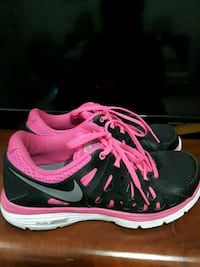 pair of black-and-pink Nike running shoes Lakeside, B3T 1K6