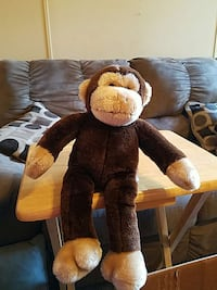 brown and gray monkey plush toy