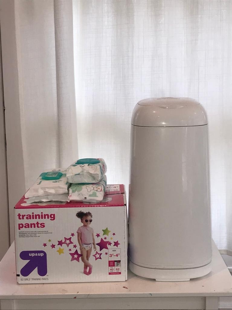 Photo Diaper genie , diapers and wipes