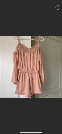 Small long sleeved baby pink romper