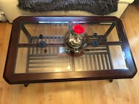 Wood  framed glass coffee table  Fayetteville, 30215