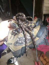 Pair of gray-and-black leather hiking boots  Winnipeg, R2W 1K9