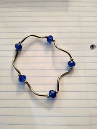 brown and blue pendant necklace