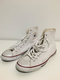 pair of white high-top sneakers 3740 km