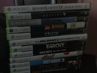 Xbox 360 with 12 games, two controllers, and controller charger. North Aurora, 60542