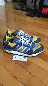 blue and yellow Adidas sneakers