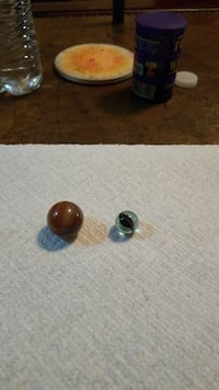 Marbles , brown one is  Oxblood .very rare .make o Owensboro, 42301