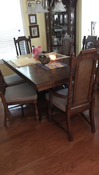 One arm chair five side chairs, chairs have cushion seats two leaves for the table chairs have wicker back Orangeburg, 29115