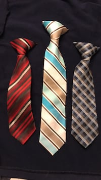 three assorted-color-and-pattern neckties