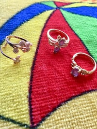 Assorted rings for sale / each priced $35  Rose gold ring size #5 and  2 Amethyst light purple gemstone rings each $35  39 km