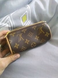 brown Louis Vuitton leather wristlet Guelph, N1E 2C1