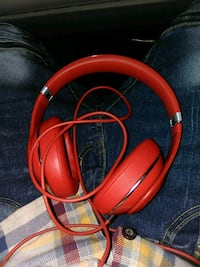 red and gray corded headphones