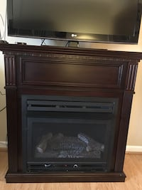 "Coffee colored gas fireplace with blower. Dual burner and electric ignition. Thermostat controlled. NEW used once. 42"" Johnson City, 37601"