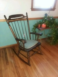 Antique Brown wooden rocking chair and pad.  Mullica Hill, 08062