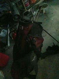 red and black golf bag with irons Joliet