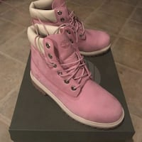 pair of pink Timberland size 7 womens work boots 69 km
