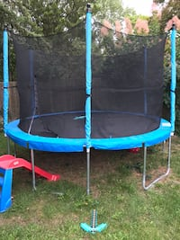 blue and black trampoline with enclosure Toronto, M3B 2Z3