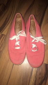 pair of pink Vans low-top sneakers