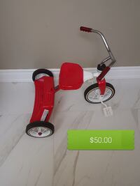 red and white Radio Flyer pedal trike