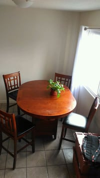 round brown wooden table with four chairs dining s 3148 km