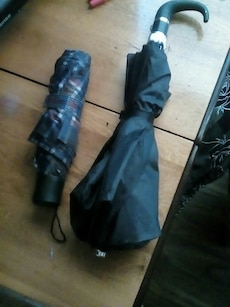 two black folding umbrellas