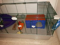 red and blue metal pet cage Calgary, T2J 6V5