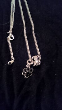 silver-colored dog pendant necklace