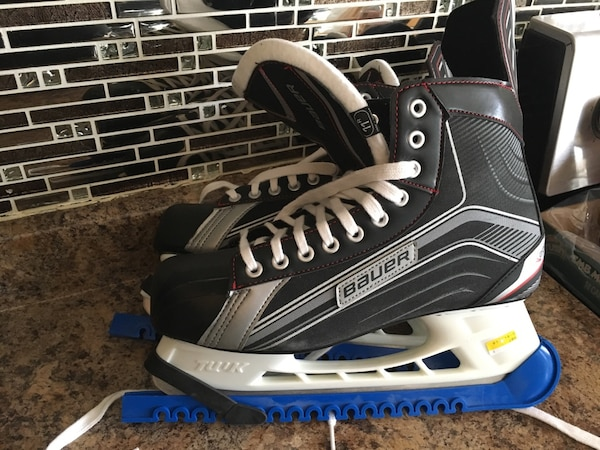 pair of black-and-white Bauer ice skates