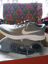 pair of black-and-white Nike running shoes Bossier City