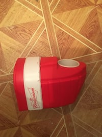 red and white plastic container 782 km