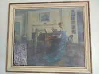 woman wearing blue dress playing piano painting with white wooden frame