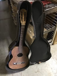 Acoustic guitar with carrying case $75
