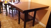 rectangular brown wooden dining table null