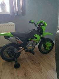 green and black trike with training wheels Leeds, LS12