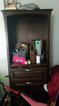 black wooden TV hutch with flat screen television Davenport, 33897