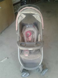baby's gray and white Graco stroller
