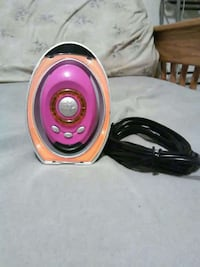 pink and beige electric home appliance