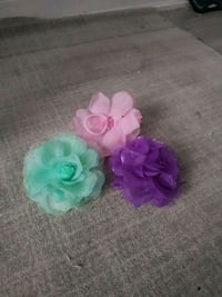 three assorted-color flower accent hair ties