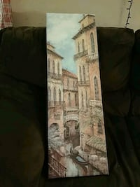 brown wooden framed painting of building