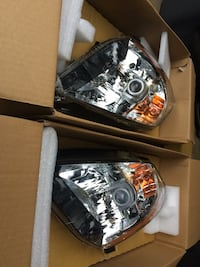 Nissan 350 headlights new in box