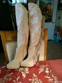 pair of tan leather side-zip knee-high boots Panama City, 32405