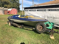 blue and white motorboat with trailer Ward, 72176